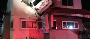 FUNNY: Flying car crashes into second floor of building